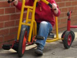 Outside on bikes and trikes